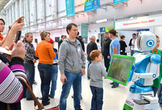 People comminicate whith android robot in Sochi. SOCHI, RUSSIA - November 21, 2014: People comminicate whith android robot in Sochi. Here there was the World Royalty Free Stock Photography