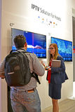 People communicate during exhibition, Stock Photo