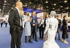 People communicate with the robot. Stock Photography
