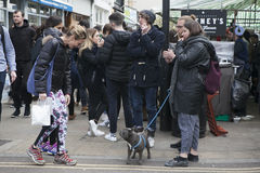 People communicate in the street on market day on Broadway Road Market. Many stroll with dogs Royalty Free Stock Photo