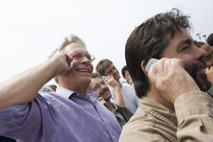 People Communicating On Phone Royalty Free Stock Photos