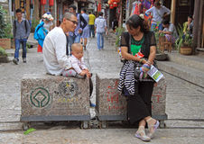 People are communicating on the street in Lijiang Royalty Free Stock Images
