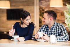 People, communication and dating concept - happy couple drinking tea at cafe Stock Photography