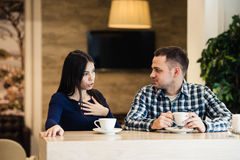 People, communication and dating concept - happy couple drinking tea at cafe. People, communication and dating concept - happy couple drinking tea and coffee at stock photos