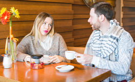 People, communication and dating concept - happy couple drinking tea at cafe or restaurant Stock Images