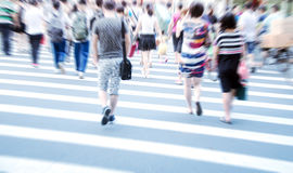 People commuting in rush hour at zebra crossing Stock Photo