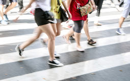 People commuting in rush hour at zebra crossing Stock Photography