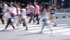 People commuting in rush hour at zebra crossing Stock Image