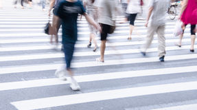 People commuting in rush hour at zebra crossing Royalty Free Stock Photos