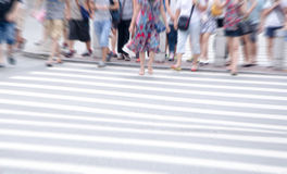 People commuting in rush hour at zebra crossing Stock Photos