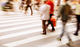 People commuting in rush hour at zebra crossing Royalty Free Stock Images