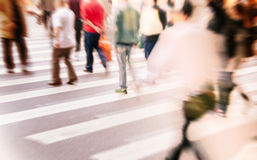 People commuting in rush hour at zebra crossing Royalty Free Stock Photo