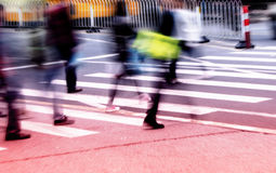 People commuting in rush hour at zebra crossing Royalty Free Stock Photography