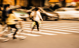 People commuting in rush hour at zebra crossing Stock Images
