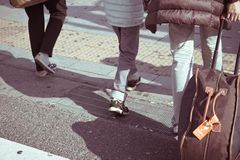People commuting in rush hour at zebra crossing Royalty Free Stock Image