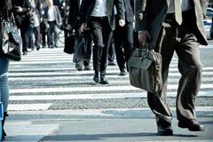 People commuting in rush hour at zebra crossing