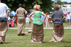 People Compete In Sack Race At Spring Festival Stock Photos
