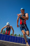 People competing in a triathlon Stock Photo