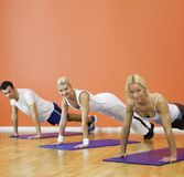 People completing push ups Stock Image
