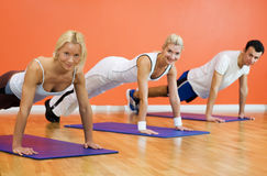 People completing push ups Royalty Free Stock Images