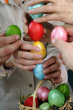 People composing easter cross from eggs Stock Photo