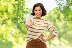 Happy smiling woman pointing finger to you royalty free stock photos