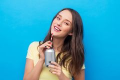 Young woman or teenage girl drinking soda from can royalty free stock photography