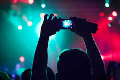 People at concert shooting video. Royalty Free Stock Photography