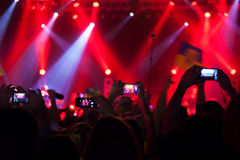People at concert shooting video. Royalty Free Stock Image
