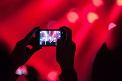 People at concert shooting video. Stock Photography