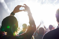 People at concert shooting video. Royalty Free Stock Photo