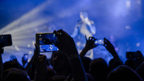 People at concert shooting video or photo. Royalty Free Stock Image