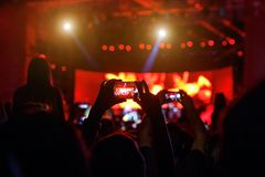 People at concert shooting video or photo. royalty free stock images