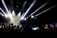 People at concert shooting video or photo. stock photography