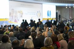 People at the conference hall. Rear view. People in the hall listen to the lecturer.  royalty free stock images