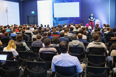 People at the conference hall. Rear view. Speaker giving a talk on scientific conference. Audience at the conference hall. Business and Entrepreneurship concept Royalty Free Stock Image