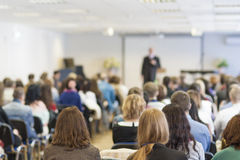 People on the Conference Listening to the Lecturer. Back View Royalty Free Stock Image