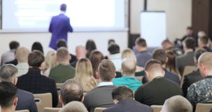 People at a conference or presentation, workshop, master class photograph. Back view stock footage