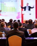 People at the conference. Speaker on the podium. People at the conference hall. Rear view stock photos