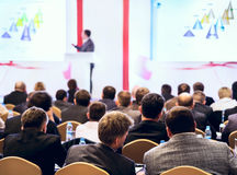 People at the conference. Speaker on the podium. People at the conference hall. Rear view stock images
