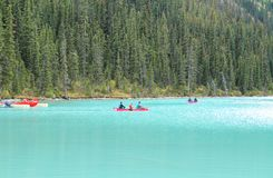 People conoeing on the Lake Louise royalty free stock photos