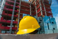 People on the construction and safety technic concept photo. Yellow helmet on the construction site Stock Image