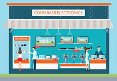 People in consumer electronics store. People in consumer electronics store, Electronics store interior and exterior building, laptops, mobile phones, television Royalty Free Stock Photography