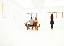 People contemplating artworks Royalty Free Stock Image