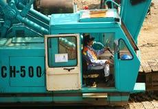 People control excavator Stock Photos