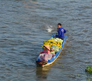 People control motorboat on river in Vietnam. People control motorboat on Mekong river in Ben Tre, Vietnam royalty free stock photography