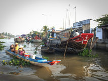 People control motorboat on river in Vietnam. People control motorboat on river in Mekong Delta, southern Vietnam royalty free stock images