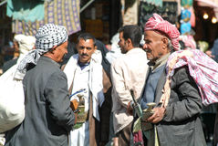 People in conversation on the main square of old Sana Stock Images