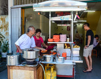 People cooking Chinese foods at downtown in Penang, Malaysia.  royalty free stock image