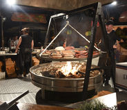 People cooking meat food Royalty Free Stock Image